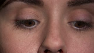 Woman Applying Mascara to Eyes