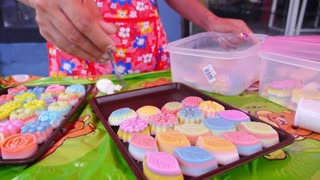Woman Cooking Colorful Jelly for Dessert