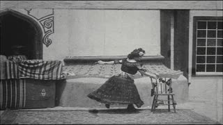 Woman Dancing With Chair in Her Mouth in Vaudeville Show