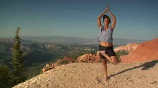 Woman Does Yoga Above Bryce Canyon National Park