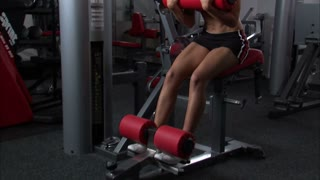 Woman Doing Ab Workout in Gym Weight Room 7
