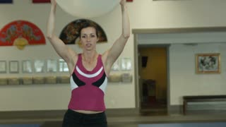 Woman Doing Dips with Exercise Ball
