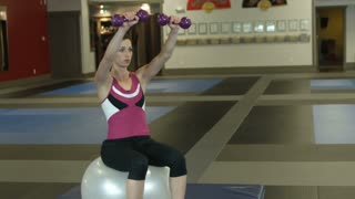 Woman Doing Dumbbell Lifts 3