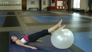 Woman Doing Exercise on Ball