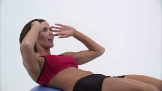 Woman Doing Sit-Ups on an Exercise Ball 2