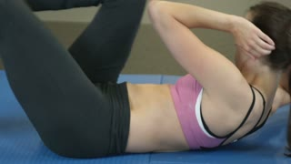 Woman Doing Stomach Exercises