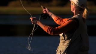 Woman Fly Fishing On Park Lake
