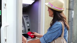 Woman gets money from ATM