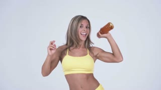 Woman in Yellow Workout Clothes Dancing
