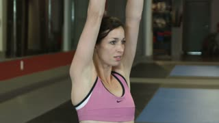 Woman Lifting Dumbbells Over Her Head