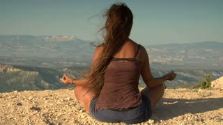 Woman Meditates Above Bryce Canyon National Park