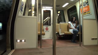 Woman on Metro Train Doors Closing