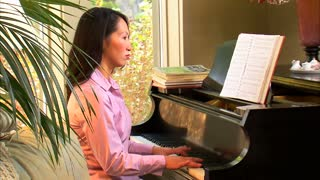 Woman Playing the Piano 2