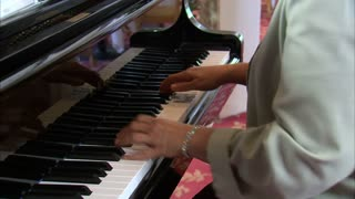 Woman Plays on the Piano 7