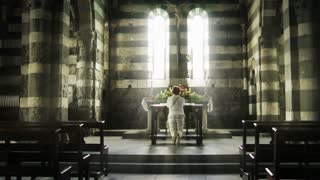 Woman praying in the Church of Saint Peter, Portovenere
