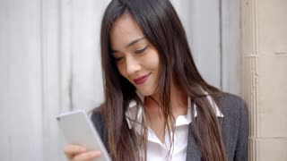 Woman reading an sms with a tender smile