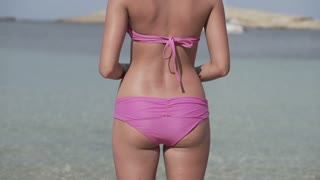 Woman relaxing on the beach, slow motion shot at 240fps