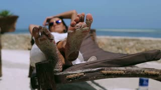 Woman resting on sunbed