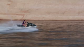 Woman Rights Jet Ski At High Speed