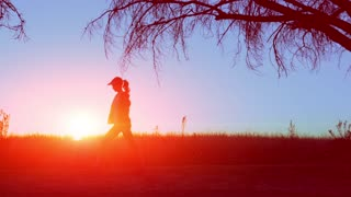 woman running/ warming up at sunrise