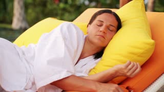 Woman sleeping on bed in the garden bed, HD