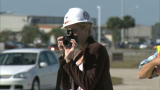 Woman Taking Pictures at Offload Barge