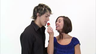 Woman Teases Man with Strawberry