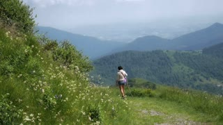 Woman trekking in a beautiful path of the italian mountains