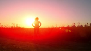 woman walking up for running at in an african sunrise