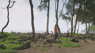Woman Walks From Ocean to Trees