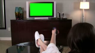 Woman watches green screened TV V1