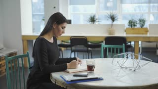 Woman working and waiting for the meeting with the business partner. UHD video