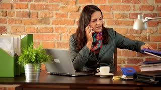 Woman working from home in apartment