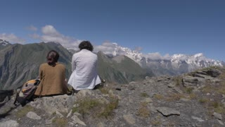 Women relaxing with alpine panorama