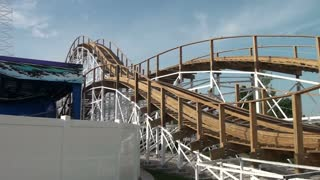 Wooden Roller Coaster Whizzes By