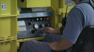 Worker Hitting Controls on Machine