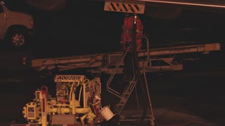Worker Refueling Jet At Night