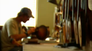 Worker Sanding Mandolin Comes Into Focus
