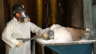 Worker With Respirator Moves Chemicals