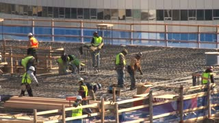 Workers On Building Roof