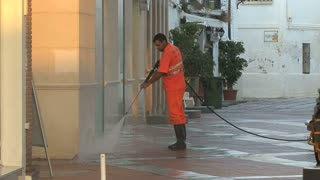 Workers Power Washing Sidewalk 3