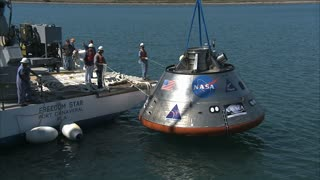 Workers Pulling In Orion Module From Ocean
