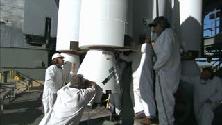 Workers Standing Around Base of Rocket