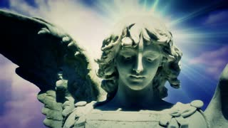 The statue of an Angel on time lapse blue clouds (Video Loop)
