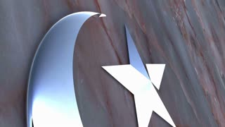 A chrome Muslim symbol in front of a stone wall.