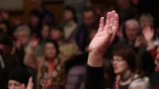 Worship, Hand Raised At Church During In Congregation During Service. One hand raised at worship