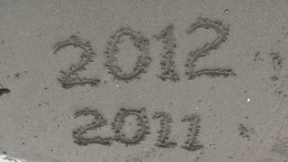 Year Written In Sand Washed Away