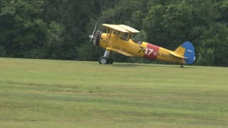 Yellow Airplane Taxiing on Grass Field