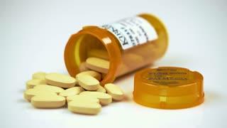 Yellow Pills in Prescription Bottle 2