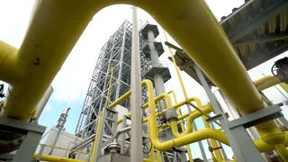 yellow pipe on gas plant. shot with slider